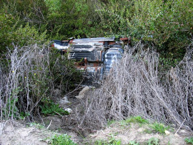 Overturned Car in a Ravine