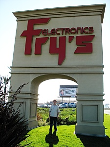 Shawn under the Fry's sign