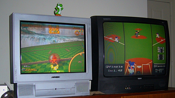 Gamecube with Super Monkey Ball 2 on the left.  NES with RBI Baseball on the right.